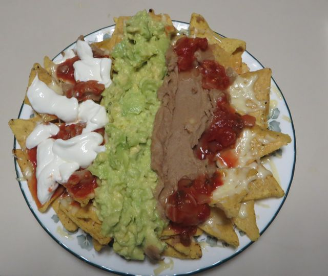 Homemade nachos the other night.  We had to use up some of that delicious avocado.  That was dinner, no need for anything more.