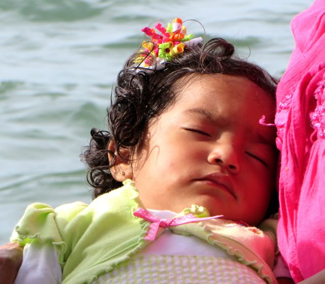 The baby slept through the entire crossing despite the waves and loud talk around her.