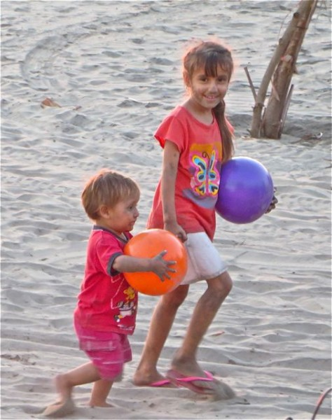 Loved watching thse two kids play with theis mom on the beach just before sudnset.