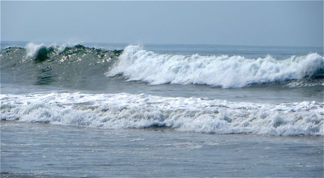 The waves are getting larger and more frequent.