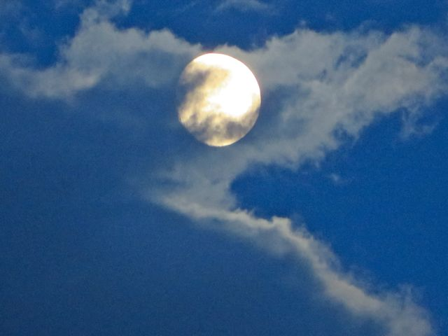 Just the other night the moon was playing g\in the clouds.