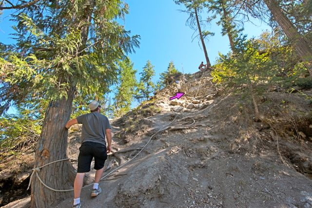 The ropes have been place by hikers.  Impossible to go up and down without the rope.  The arrow shows where the trail goes straight up.