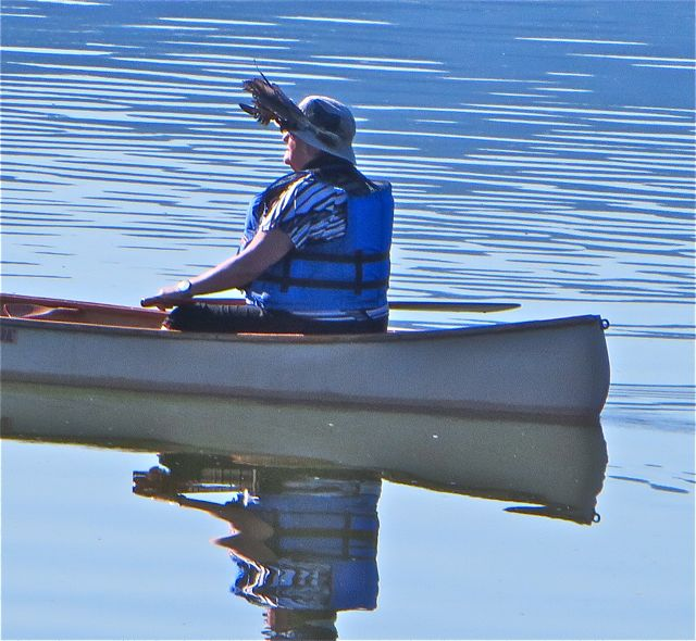 We see this couple canoeing almost weekly and each time she wears these feathers in her hat.  So intringuing