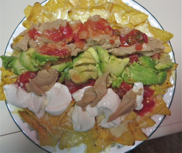 After a late lunch we had an even later dinner but somewhat lighter.  My version of nachos with tons of chihuahua cheese, refried beans, guacamole, salsa and sour creme.  Not so light a dinner after all, my stomach  is full but oh so tasty.