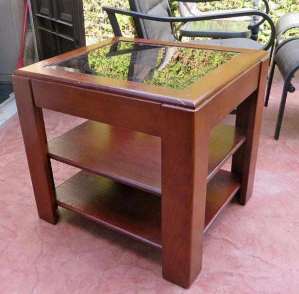 This table has sat between our two teal recliners for years and years and years.