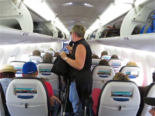"""A very tight flight. Even at 5'4"""" I kept hitting my head on the overhead bins."""