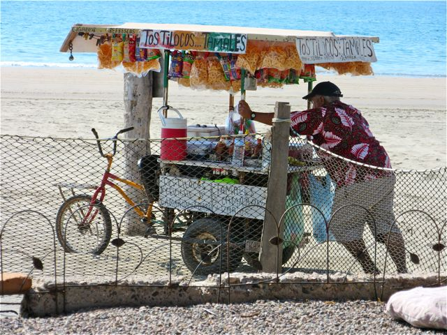 Can you imagine having to push this heavy cart up and down the beach each day to make a living?