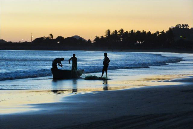 A few young fishermen coming in at the end of the day.