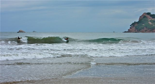 The local yhoung surfers were certainly enjoying the aftermath of the storm.